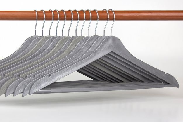 Set of gray clothes hangers on a white background