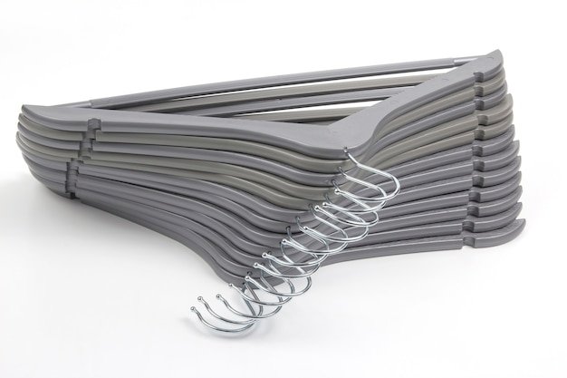 Set of gray clothes hangers on a white.