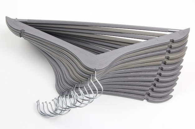 Set of gray clothes hangers on white