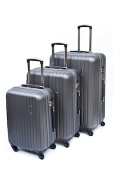 Set of gray suitcases large, medium and small isolated on white.
