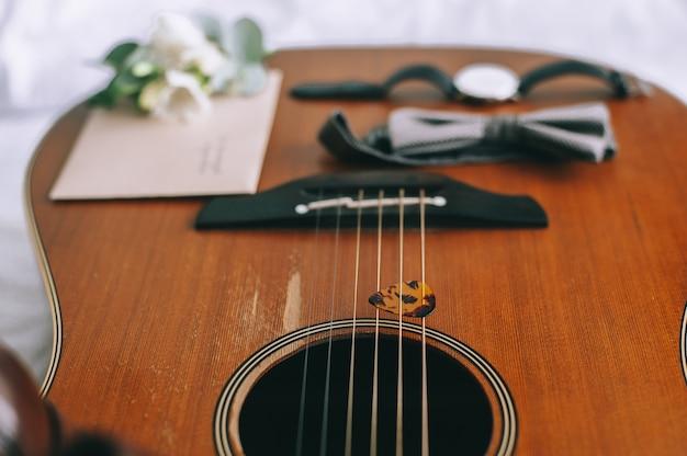 Set groom butterfly shoes belts cufflinks watches men's accessories on guitar