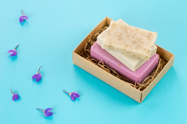 Set of handmade soap on a blue background