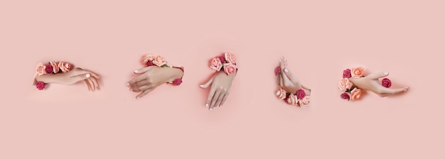 Set hands with artificial flowers sticking out of hole pink paper background. hand in various poses, the pattern layout for your collage. cosmetics hand skin care, moisturizing and wrinkle reduction