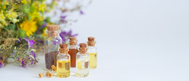 Set healthy essential oils on white table