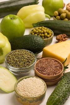 Set of healthy food cheese leafy vegetables, beans nuts, quinoa bulgur, chickpeas
