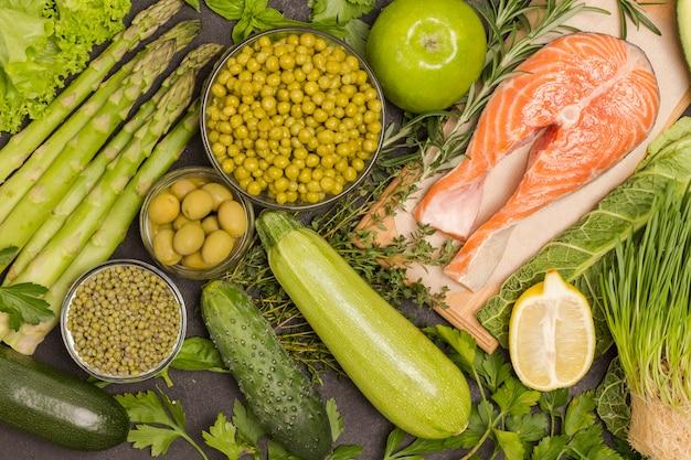 Set of healthy food with salmon, vegetables, beans, quinoa, bulgur, chickpeas