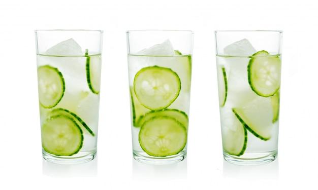 Set of homemade cucumber iced lemonades in crystal glasses