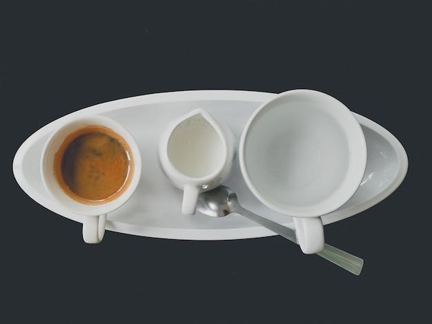 Set of hot espresso coffee include milk sugar tea and sugar on table