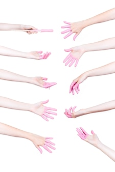 Set of human hands with pink paint on white background
