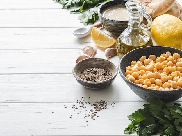 Set of ingredients for cooking homemade traditional hummus. copy space