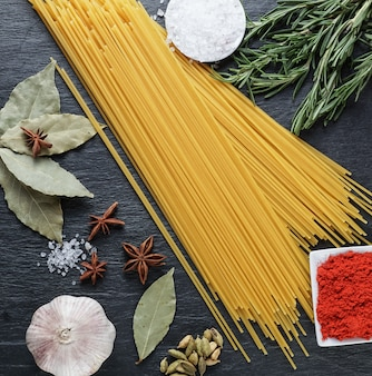 Set of ingredients for pasta cooking, directly above view.
