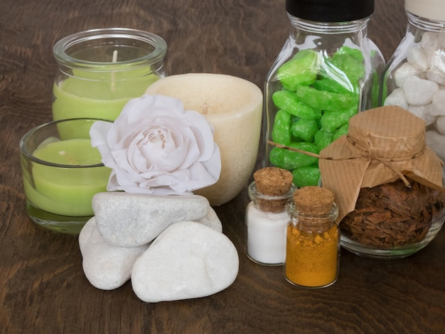 Set ingredients and spice for aromatherapy and body care on wooden surface. spa still life