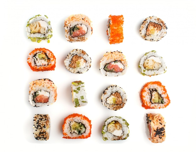 Set of japanese maki sushi rolls in a rows with salmon, sesame, avocado, cheese and cucumber