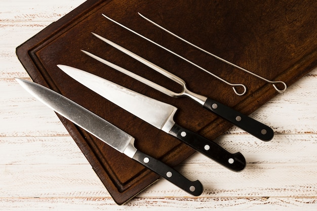 Set of kitchen knives on wooden desk