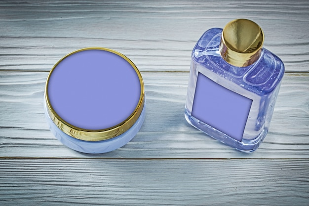 Set of lavender shower gel and body lotion on wooden board bathing concept