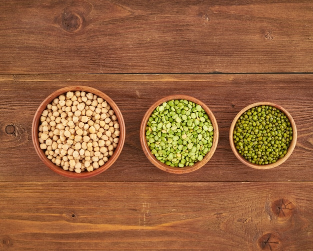 Set of legumes, beans for gluten-free protein vegan diet, green peas, chickpea, mung, top view