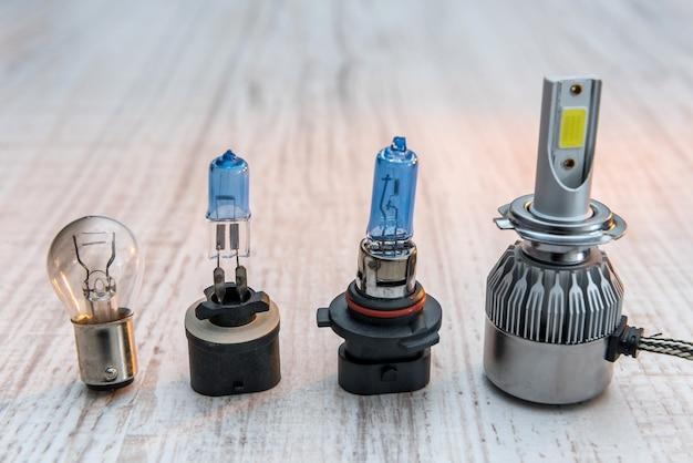 Set of light bulbs for car lamps on white wooden desk. modern technology lightbulbs for repair vechile. light equipment