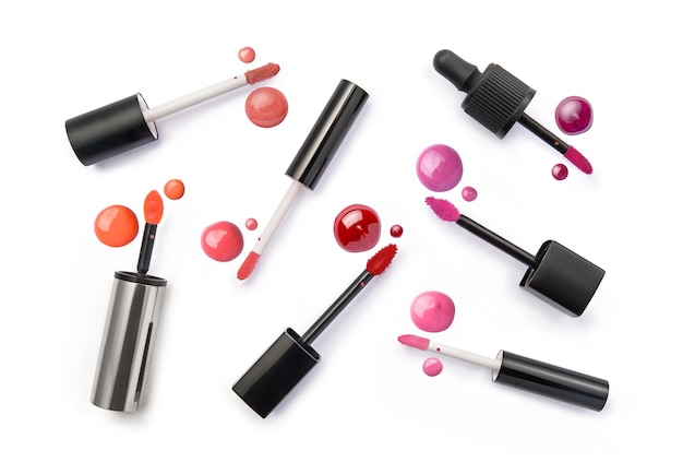Set of lip gloss in different shades on white background