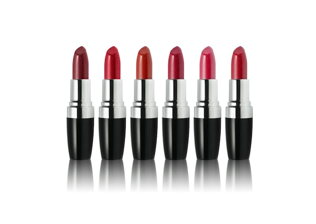 Set of lipstick in different shades on white background