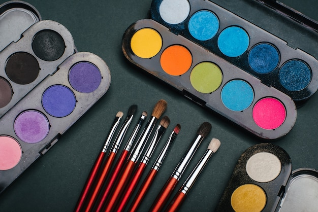 Set of makeup brushes and palette with color eye shadow