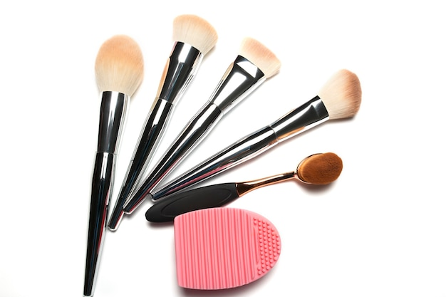 Set of makeup brushes  with brush cleaner isolated on a white background. closeup shot