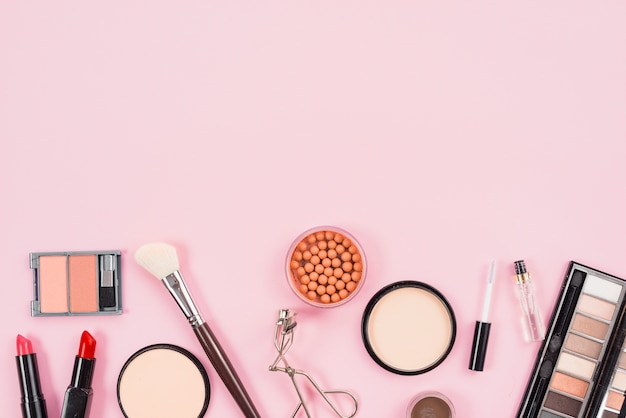 Set of makeup and cosmetic beauty products on pink background