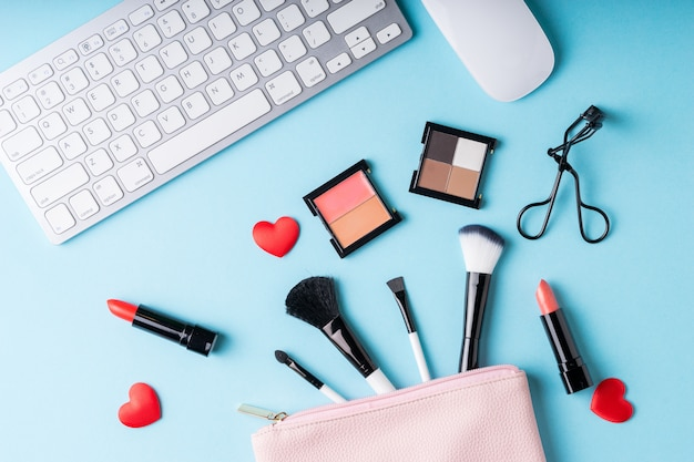 Set of makeup cosmetics products with bag on top view