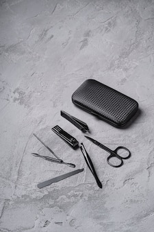 Set of manicure, pedicure tools and accessories with case, stone concrete , angle view