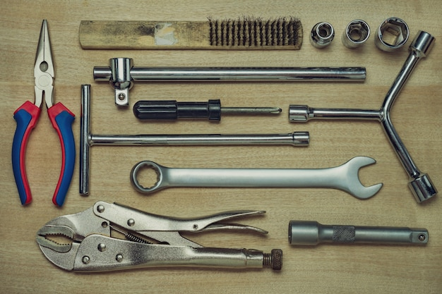 Set of many hand tools on brown wooden floor. top view of craftsman tool on wooden table. top view and full frame. concept of technician or engineer.