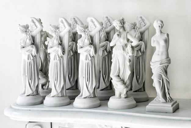 Set of marble feminine statuettes