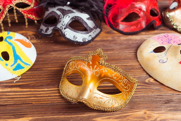 Set of masks on wooden table