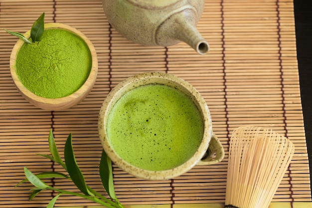 Set of matcha powder bowl wooden spoon and whisk green tea leaf organic green matcha tea ceremony