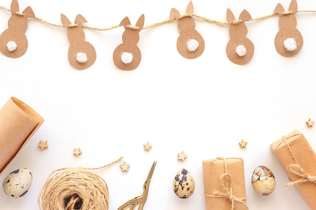Set of materials for packing holiday gifts. kraft paper, jute twine, scissors, boxes on white background. holiday zero waste