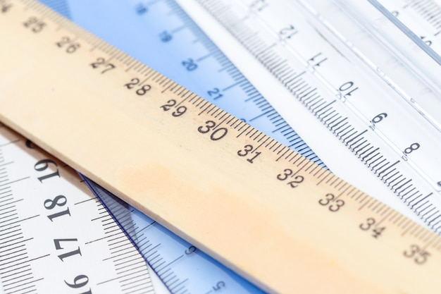Set of measuring rulers on white surface