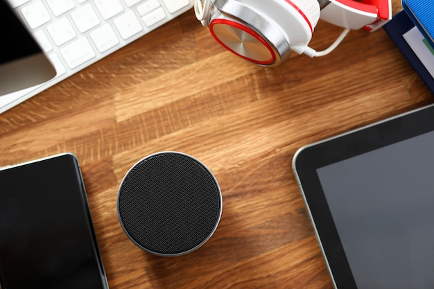 Set of media gadgets lying at table surface