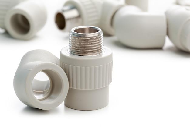 Set of metal-plastic plumbing couplings, adapters, plugs isolated