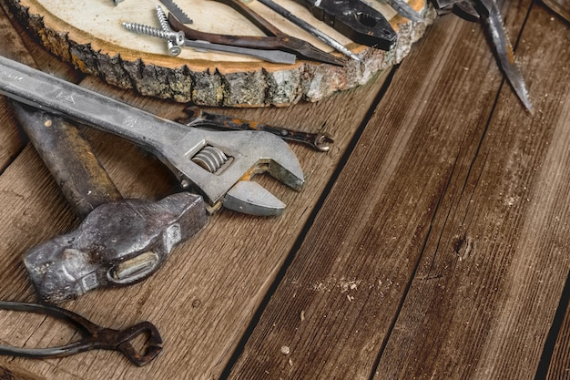 A set of metal tools in the workshop on an old rustic wooden background fathers day or labor day
