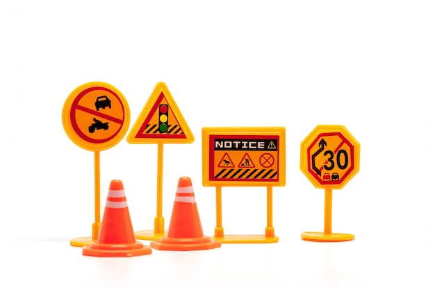 Set of mini traffic sign toy on white for transportation concept