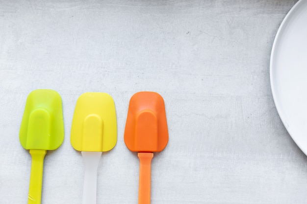 Set of multi-colored silicone spatulas, kitchen tools. sweet pastries, recipes, cooking
