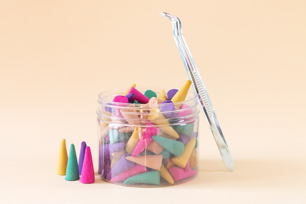 Set of multi coloured aroma incense cones or sticks in bottle
