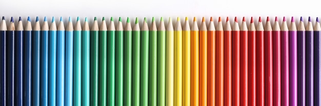 Set of multicolored pencils lying on white background