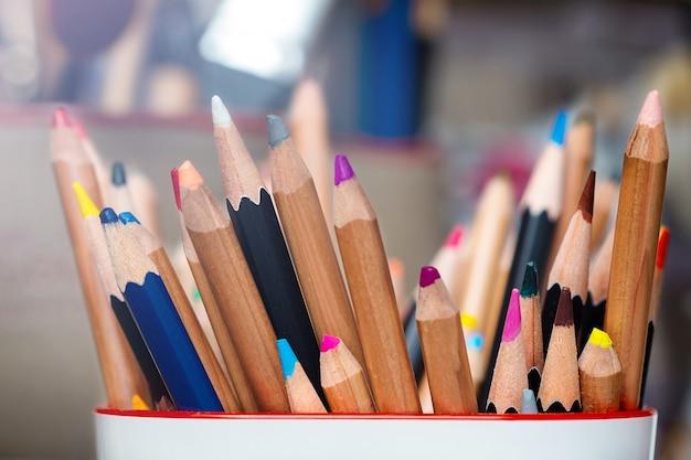 Set of multicolored watercolor pencils in artist studio