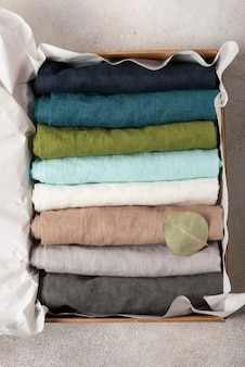 Set of natural linen napkins on the light background, textile concept
