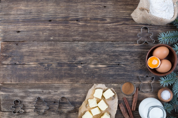 A set of natural products for making a tart on wooden background