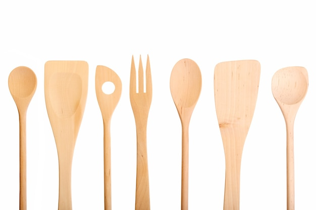 Set of new wooden kitchen utensils spoons isolated on white. macro photo.