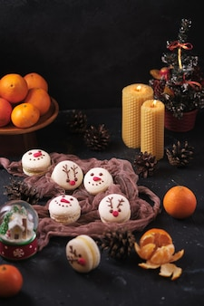 Set of new year pastries macarons with tangerine filling white chocolate and cream