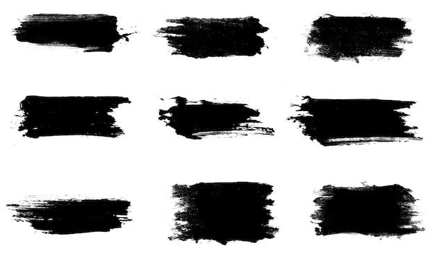 Set of nine black strokes of paint isolated on a white background. design brush