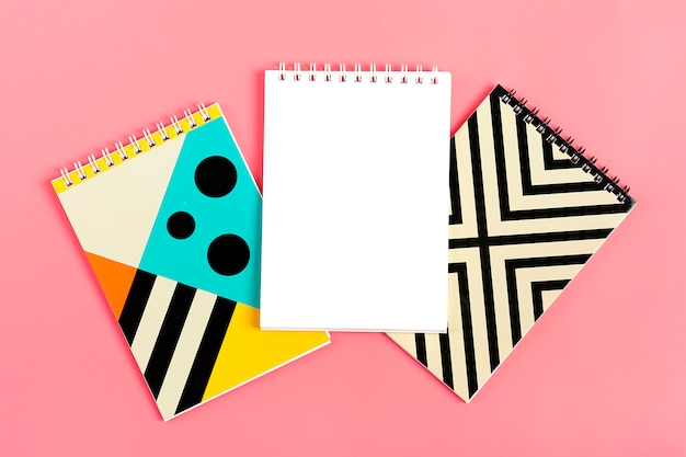 Set of notebooks for notes on pink background