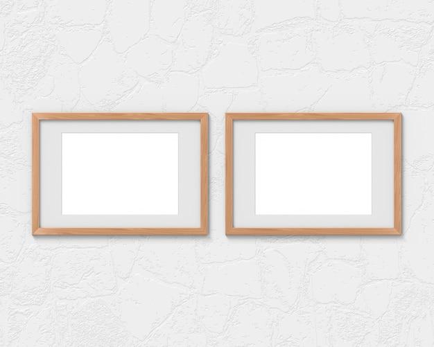 Набор из 2 горизонтальных деревянных рам с бордюром, висящим на стене. 3d-рендеринг.