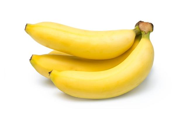 Набор бананов целиком и ломтиками, изолированные на белом фоне